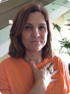 Client Success Story - Woman with Orange shirt